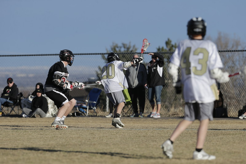 JPM0295-JPM0295-Jonathan first HS lacrosse game March 9th.jpg