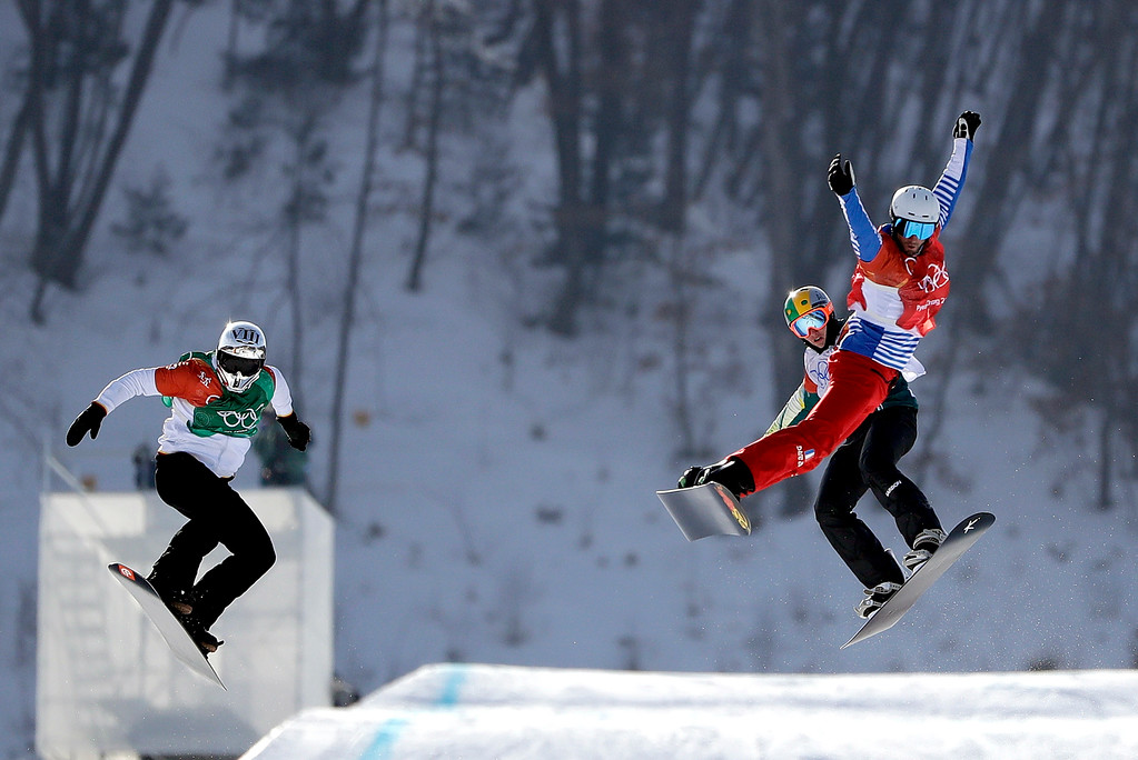 . From left; Regino Hernandez, of Spain, Jarryd Hughes, of Australia, and Pierre Vaultier, of France, run the course during the men\'s snowboard cross final at Phoenix Snow Park at the 2018 Winter Olympics in Pyeongchang, South Korea, Thursday, Feb. 15, 2018. (AP Photo/Gregory Bull)