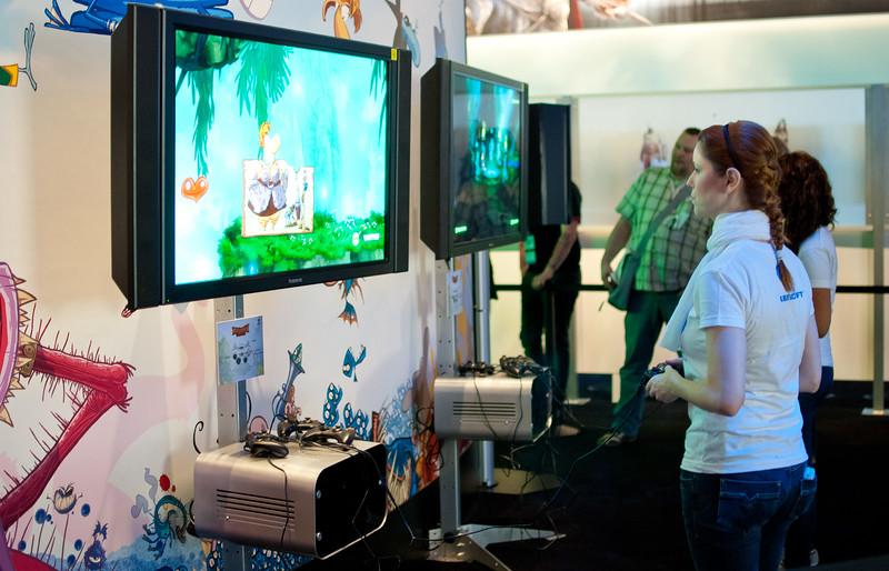 Girl playing Rayman at GamesCom 2011