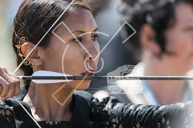 Close up on the face of a female archer ready to shoot during a competition at the World Nomad Games 2018 in Kyrgyzstan.