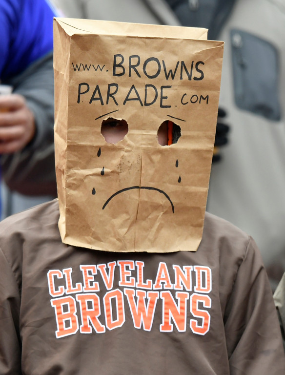 . A Cleveland Browns fan watches before an NFL football game between the Baltimore Ravens and the Cleveland Browns, Sunday, Dec. 17, 2017, in Cleveland. (AP Photo/David Richard)