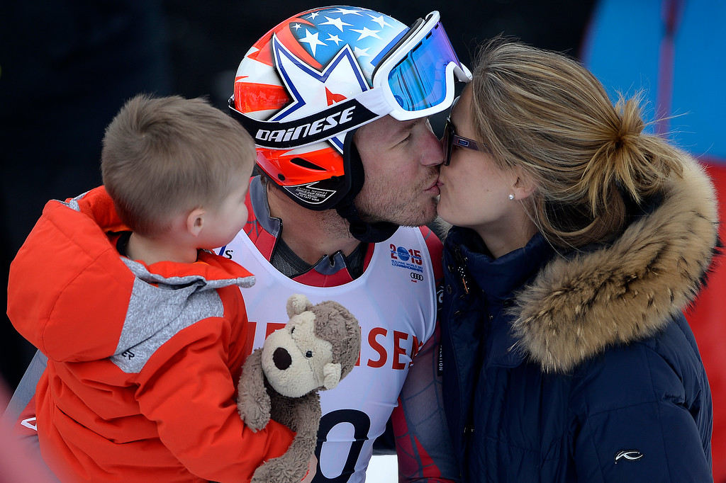 . BEAVER CREEK, CO - FEBRUARY 03: USA skier Bode Miller holds his son, Nate, 1, while he kisses his wife, Morgan, during the the men\'s downhill training. FIS Alpine World Ski Championships 2015 on Tuesday, February 3, 2015. (Photo by AAron Ontiveroz/The Denver Post)