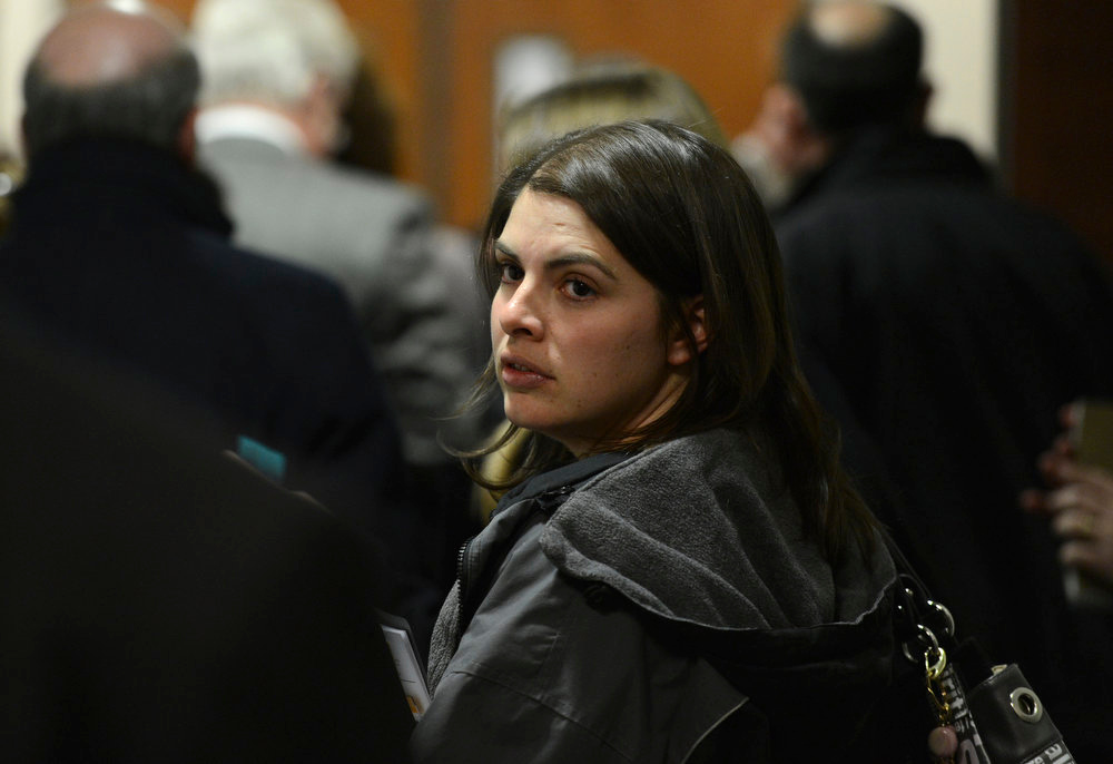 . Jessica Watts, cousin of Jonathan Blunk, leaves the court room during a break, Monday, January 7, 2013, in Centennial. RJ Sangosti, The Denver Post