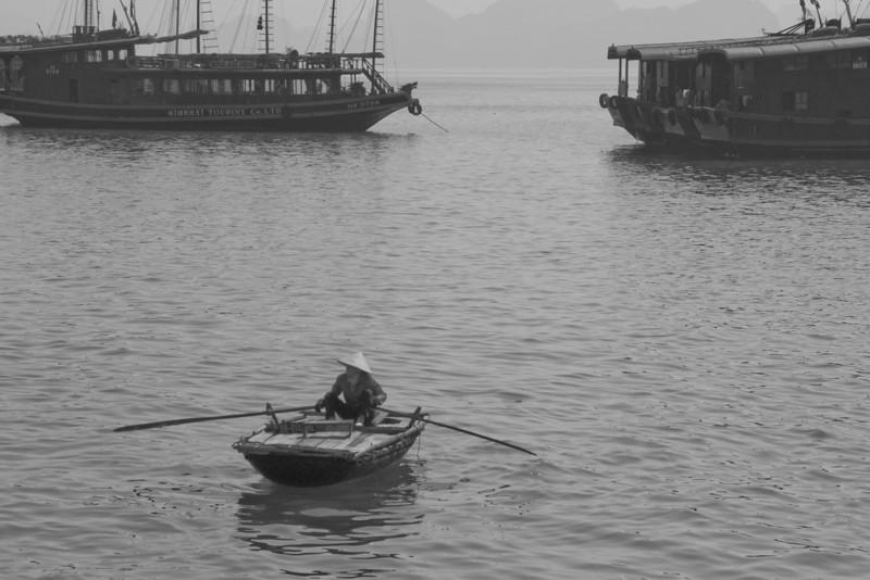 Woman rowing a boat in B&W - Ha Long Bay, Vietnam