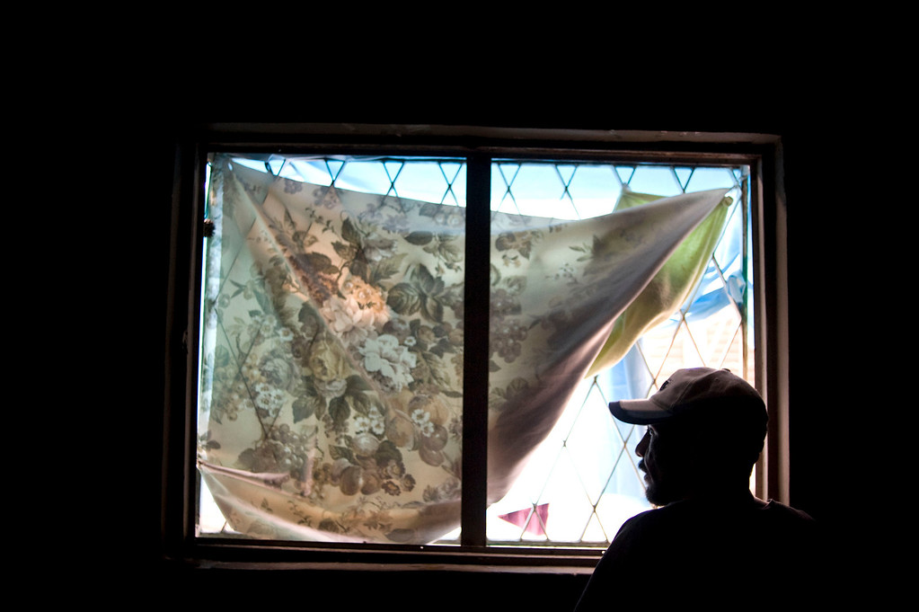 . A Mexican man who was deported from the US several years ago looks out from a window at a shelter for homeless in Tijuana, Mexico, 05 April 2013. Heightened US border security and record numbers of deportations from the US have created a growing population of people who live homeless in Mexican cities that border with the United States. Many had lived for years undocumented in the US and have little or no family and other support in Mexico, and are subject to fall into depression, substance abuse and crime. Tijuana, Mexico, borders on the US city of San Diego, California.  EPA/DAVID MAUNG