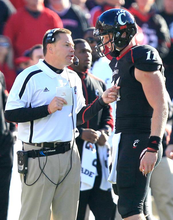 . Cincinnati head coach Butch Jones talks with quarterback Brendon Kay (11) in the second half of an NCAA college football game against Rutgers, Saturday, Nov. 17, 2012, in Cincinnati. Rutgers won 10-3. (AP Photo/Al Behrman)