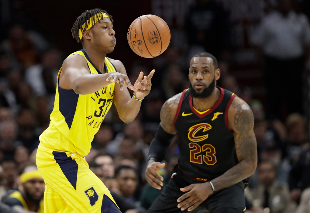 . Indiana Pacers\' Myles Turner (33) passes against Cleveland Cavaliers\' LeBron James (23) in the first half of Game 7 of an NBA basketball first-round playoff series, Sunday, April 29, 2018, in Cleveland. (AP Photo/Tony Dejak)
