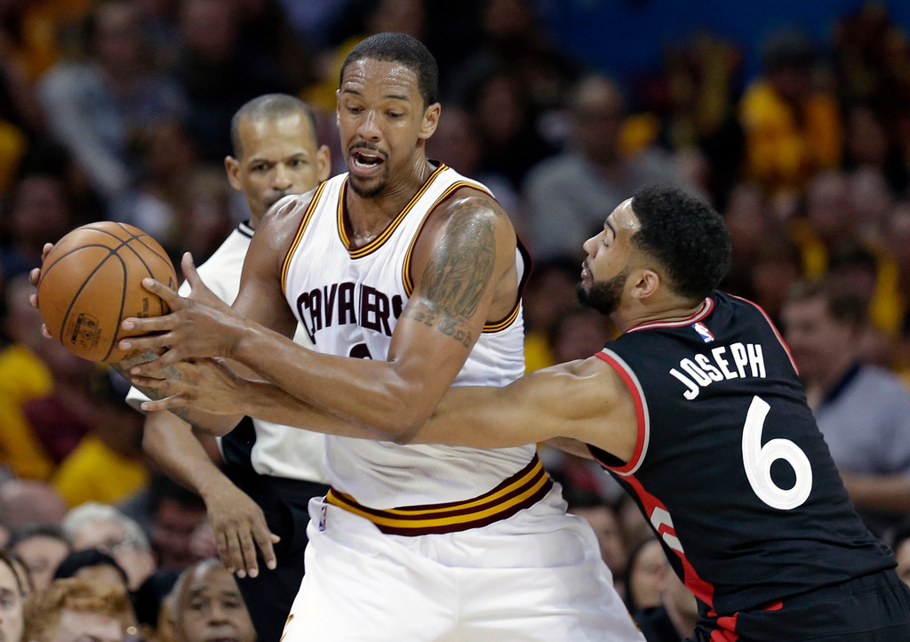 . Toronto Raptors\' Cory Joseph (6) puts pressure on Cleveland Cavaliers\' Channing Frye, center, in the first half in Game 1 of a second-round NBA basketball playoff series,, Monday, May 1, 2017, in Cleveland. (AP Photo/Tony Dejak)