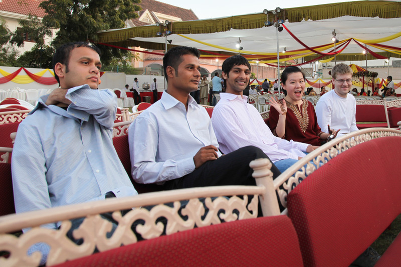 The groom and some friends sit and listen to some music at the Mehndi Party.