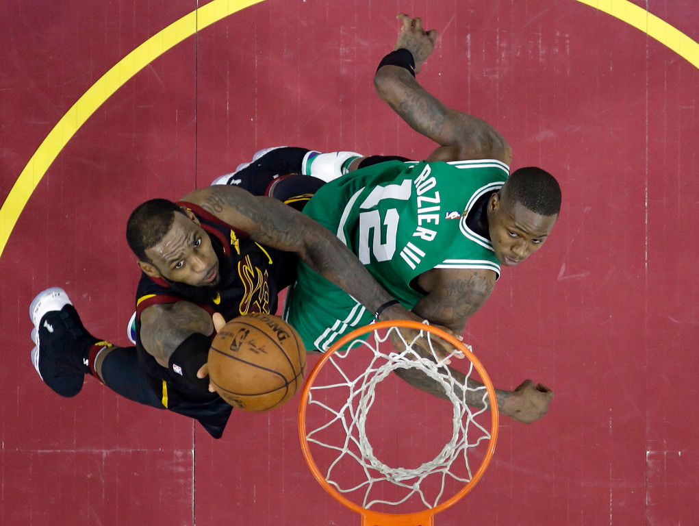 . Cleveland Cavaliers\' LeBron James, left, drives to the basket against Boston Celtics\' Terry Rozier in the second half of Game 3 of the NBA basketball Eastern Conference finals Saturday, May 19, 2018, in Cleveland. The Cavaliers won 116-86. (AP Photo/Tony Dejak)