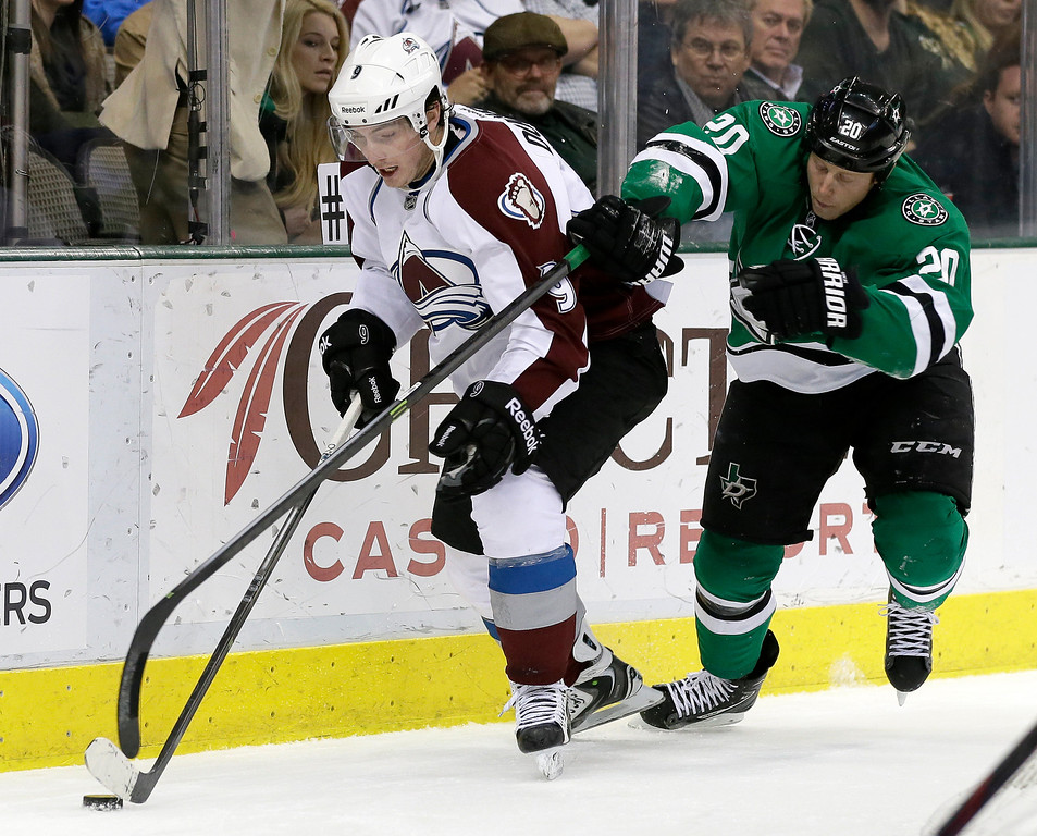 . Colorado Avalanche\'s Matt Duchene (9) is challenged by Dallas Stars\' Cody Eakin (20) for control of the puck in the second period of an NHL hockey game, Monday, Jan. 27, 2014, in Dallas. (AP Photo/Tony Gutierrez)