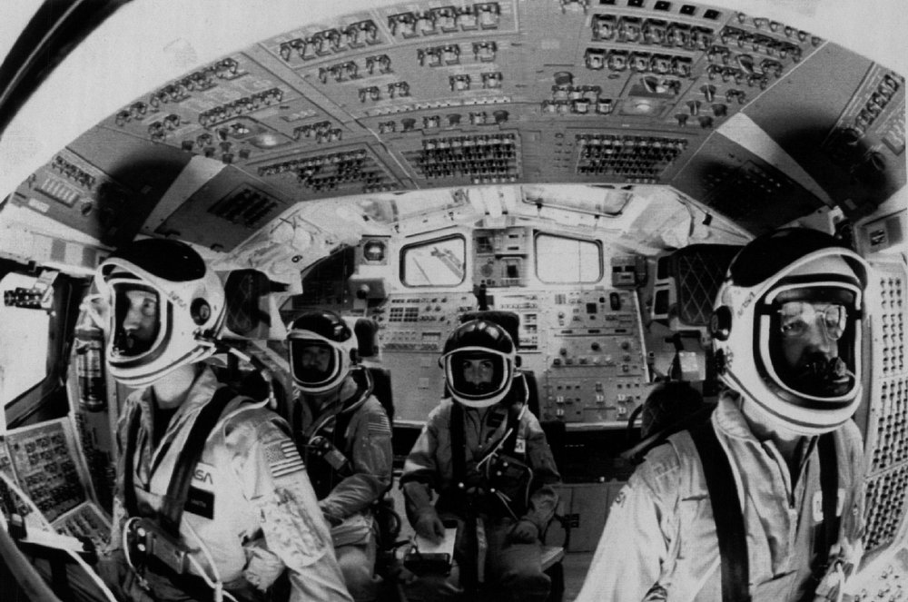 Description of . The Space Shuttle 51L crew is shown during simulation at the Johnson Space Center before their ill fated flight. (LtoR) Mike Smith Ellison S. Onizuka, Judith  A. Resnik and commander Franis R. (Dick) Scobee. The other three members of the crew would be seated on a lower deck during takeoff. Denver Post Library Archive