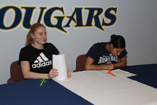 Melisa and Kellie signing