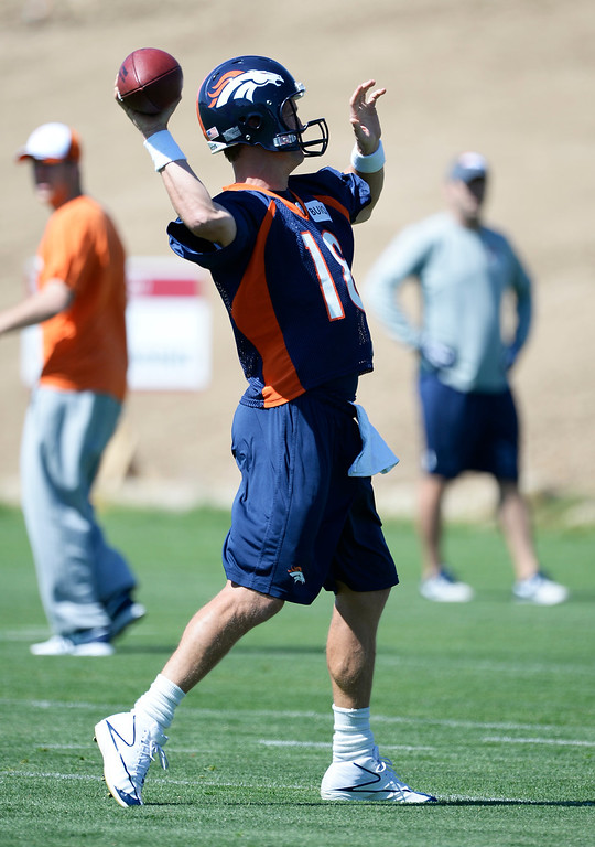 . Denver Broncos Peyton Manning (18) throws a pass during OTAs June 2, 2014 at Dove Valley. (Photo by John Leyba/The Denver Post)