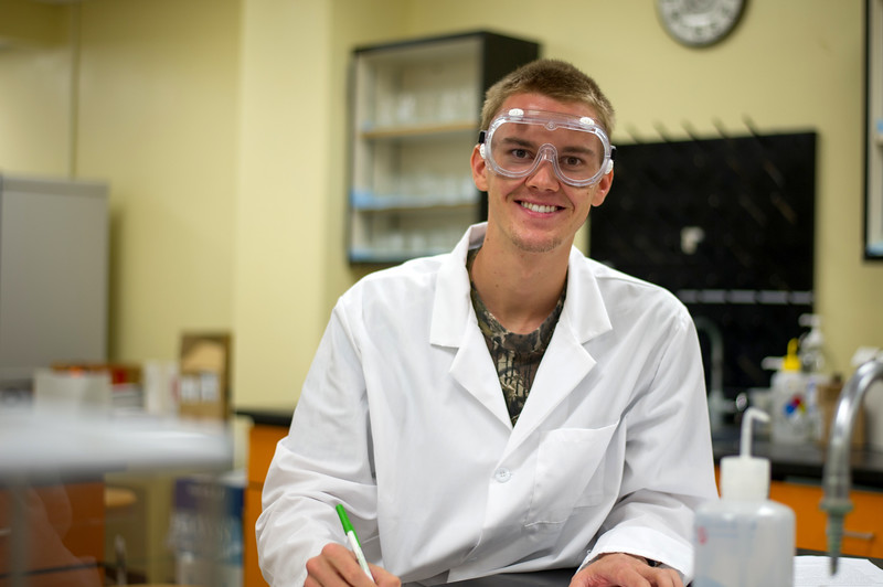 Spencer Swenson takes a second to smile while finishing up his test in General Chemistry.