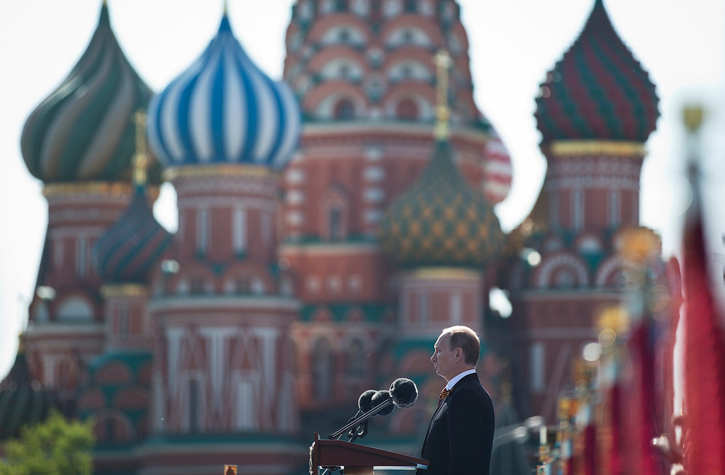 . Russian President Vladimir Putin speaks during a Victory Day Parade, which commemorates the 1945 defeat of Nazi Germany, in Red Square, with St. Basil Cathedral in the background, in Moscow, Russia, Friday, May 9, 2014. Putin made no reference to the situation in Ukraine when he opened Friday\'s parade, focusing on the historic importance of the victory over Nazi Germany. (AP Photo/Pavel Golovkin)