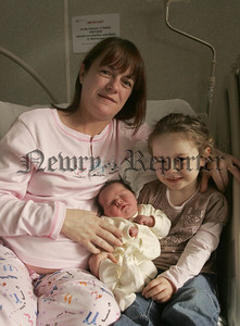New Year Baby Ciara McGrath from Banbridge born at  8:30am New Years Day at 7lbs 11ozs pictured with her mother Yvonne and big sister Alanna. 06W1N8