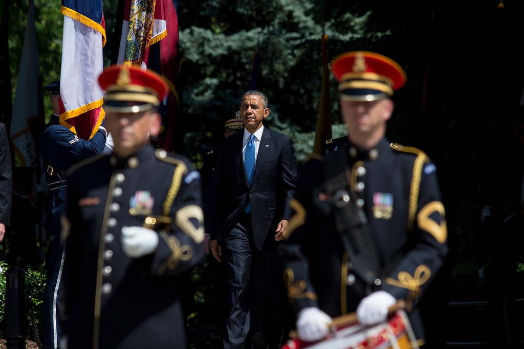 . U.S. President Barack Obama arrives for a wreath laying ceremony at the Tomb of the Unknown Soldier at Arlington National Cemetery, May 26, 2014 in Arlington, Virginia. Obama returned to Washington the morning  of May 26, after a surprise visit to Afghanistan to visit U.S. troops at Bagram Air Field. (Pool photo by Drew Angerer/Getty Images)
