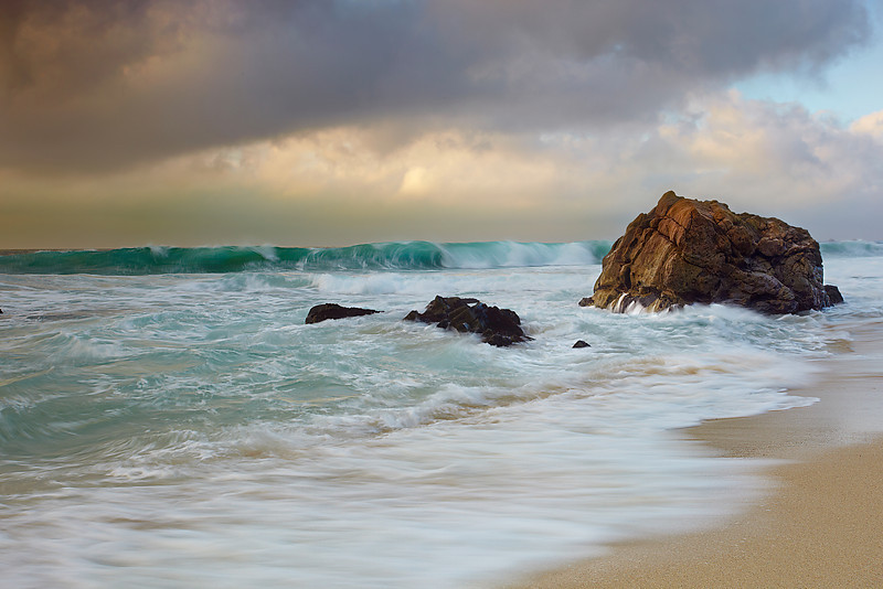I noticed the aquamarine-green color of the waves that appeared for just a fraction of a second in front of the dramatic sky.  So I set up and waited until I had captured it just right.