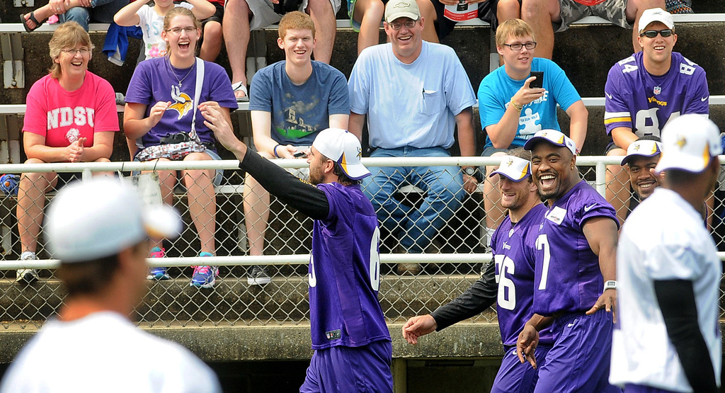 . Vikings fans laugh as defensive end Jared Allen waves to teammates and fans as he entered the stadium with teammates Brian Robison and Everson Griffen for morning practice. (Pioneer Press: Sherri LaRose-Chiglo)