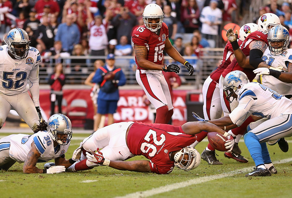. Running back Beanie Wells #26 of the Arizona Cardinals reaches with the football as he attempts to score against the Detroit Lions during the NFL game at the University of Phoenix Stadium on December 16, 2012 in Glendale, Arizona.  (Photo by Christian Petersen/Getty Images)