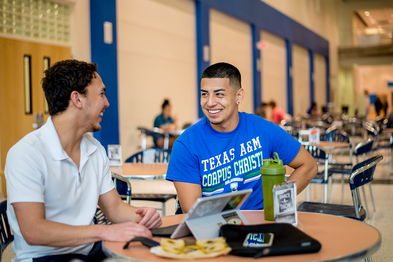 Sam Siqueiros (left), and Bradley Roblos stop by the Island Hall lounging area before their morning classes.