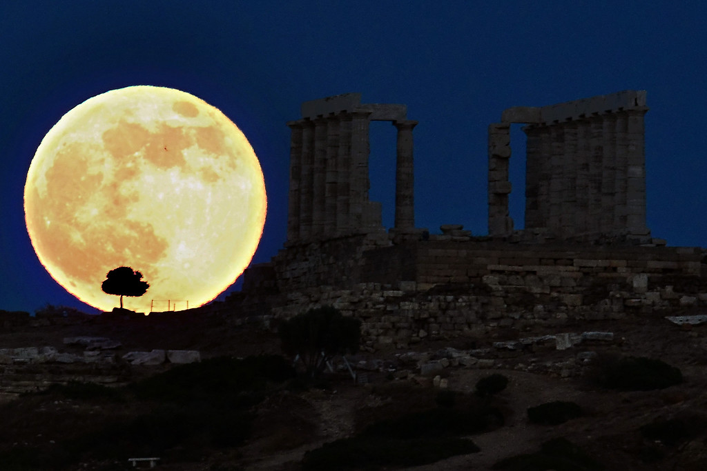 . A supermoon rises next to the ancient Greek temple of Poseidon at Cape Sounion, about 65 kilometers south of Athens, on June 23, 2013.   ARIS MESSINIS/AFP/Getty Images