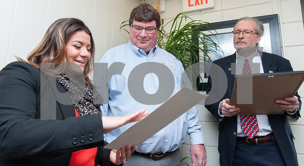 02/20/18 Wesley Bunnell   Staff Collier Electric Corp celebrated 25 years in business with presentations on Tuesday morning by Mayor Erin Stewart and Representative William Petit Jr. Mayor Erin Stewart reads from the proclamation as President Scott Pehmoeller looks on and Representative William Petit Jr. is ready to present an award from the state.