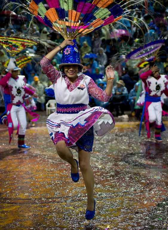 ". ""Thobas\"" dancers perform during the Carnival of Oruro, in Oruro, Bolivia, Saturday, Feb. 25, 2017. The carnival is a religious festival dating back more than 200 years in an ongoing pagan-Catholic blend of religious practice in the region, and is one of UNESCO\'s Masterpieces of the Oral and Intangible Heritage of Humanity. (AP Photo/Juan Karita)"