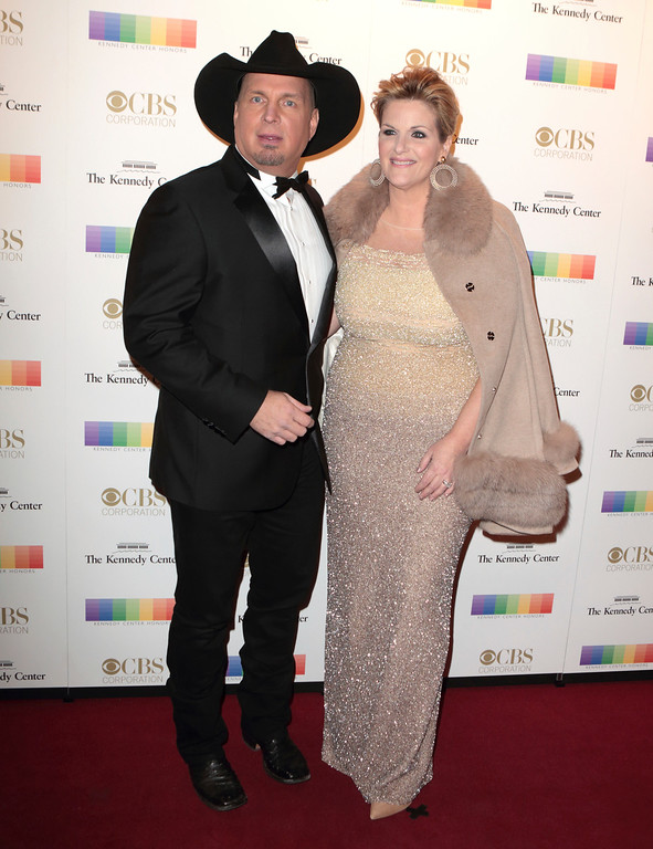 . Garth Brooks, left, with his wife Trisha Yearwood attend the 39th Annual Kennedy Center Honors at The John F. Kennedy Center for the Performing Arts on Sunday, Dec. 4, 2016, in Washington, D.C. (Photo by Owen Sweeney/Invision/AP)