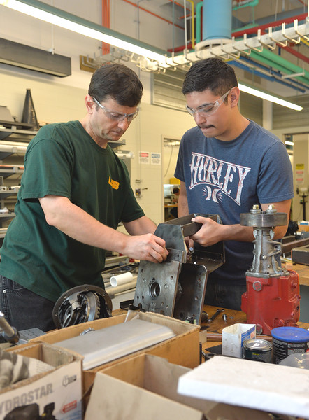 Dr. Petru Aurelian Simionescu assists senior student Josh Chapa with his Basisc Utility Vehicle capstone project.