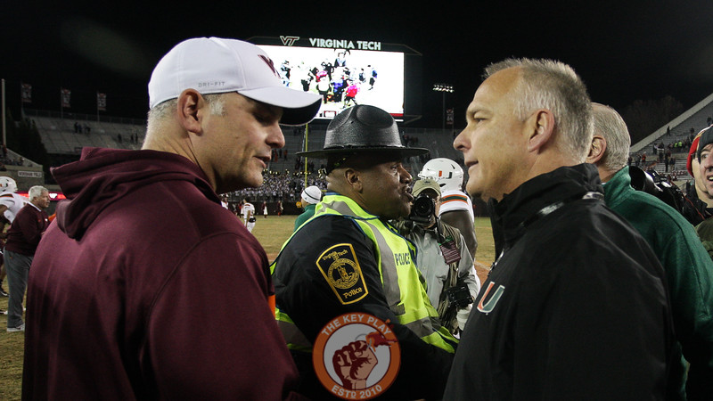 Virginia Tech head coach Justin Fuente shakes hands with Miami head coach Mark Richt after the final whistle. Miami defeated Virginia Tech 38-14. (Mark Umansky/TheKeyPlay.com)