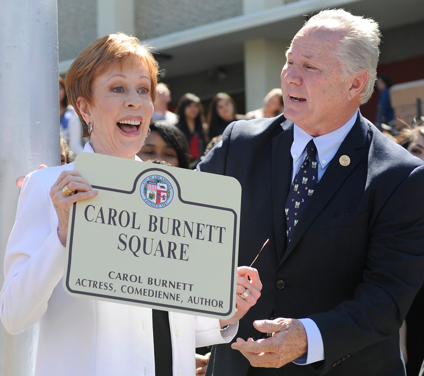 """. Carol Burnett with LA City Councilman Tom LaBonge. Burnett, award-winning actress, comedienne and best-selling author, was honored by the City of Los Angeles for her lifetime achievements with the naming of Carol Burnett Square at the intersection of Highland Avenue and Selma Avenue. The Square is adjacent to Hollywood High School where Burnett attended. Students from the school choir, \""""H2O\"""" sang �I�m so glad we had this time together,� before Burnett and LA City Councilman Tom LaBonge unveiled her street sign. Hollywood, CA 4/18/2013(John McCoy/Staff Photographer"""