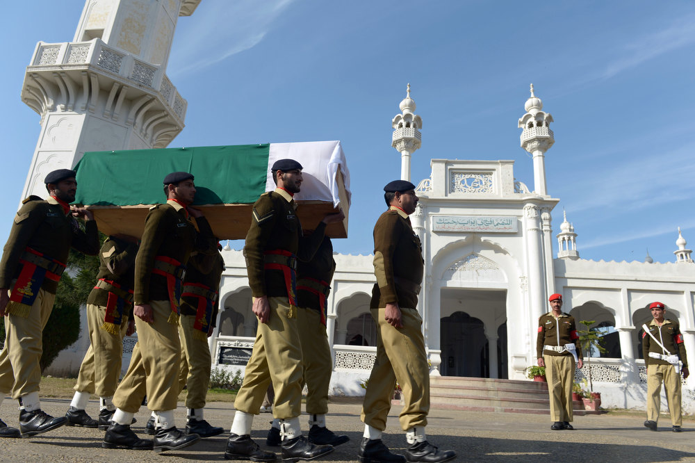 ". Pakistani soldiers carry the coffin of their fallen comrade Havildar (Sargeant) Mohyuddin, who was allegedly shot by Indian troops at the Hotspring sector in Battal in Pakistan-administered Kashmir, during his funeral in Jhelum some 100 kms of Islamabad on January 11, 2013. Pakistan said one of its soldiers was killed January 10 by ""unprovoked\"" Indian firing across their tense border in Kashmir, the third deadly incident reported in five days in the disputed region. FAROOQ NAEEM/AFP/Getty Images"