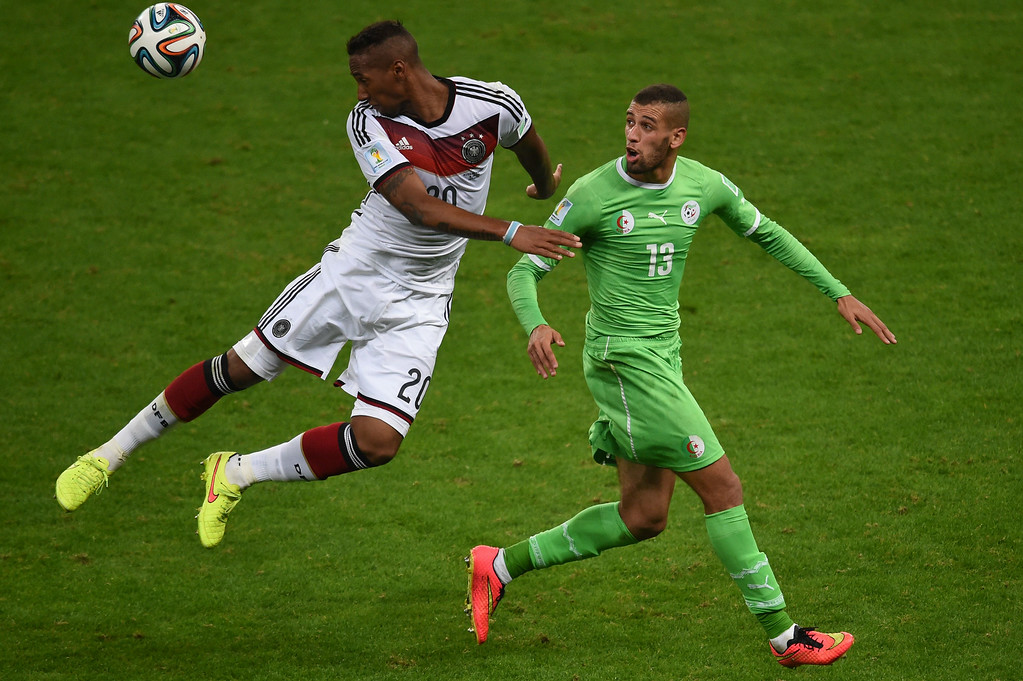 . Germany\'s defender Jerome Boateng (L) and Algeria\'s forward Islam Slimani vie during the Round of 16 football match between Germany and Algeria at Beira-Rio Stadium in Porto Alegre during the 2014 FIFA World Cup on June 30, 2014.   CHRISTOPHE SIMON/AFP/Getty Images