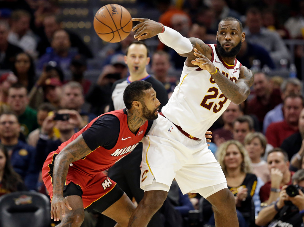 . Cleveland Cavaliers\' LeBron James (23) passes against Miami Heat\'s James Johnson (16) in the second half of an NBA basketball game, Tuesday, Nov. 28, 2017, in Cleveland. The Cavaliers won 108-97. (AP Photo/Tony Dejak)