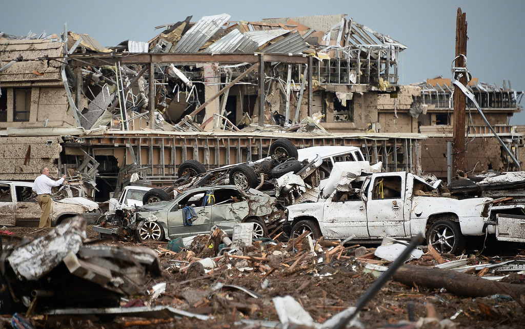 . Destroyed buildings and overturned cars are seen after a huge tornado struck Moore, Oklahoma.