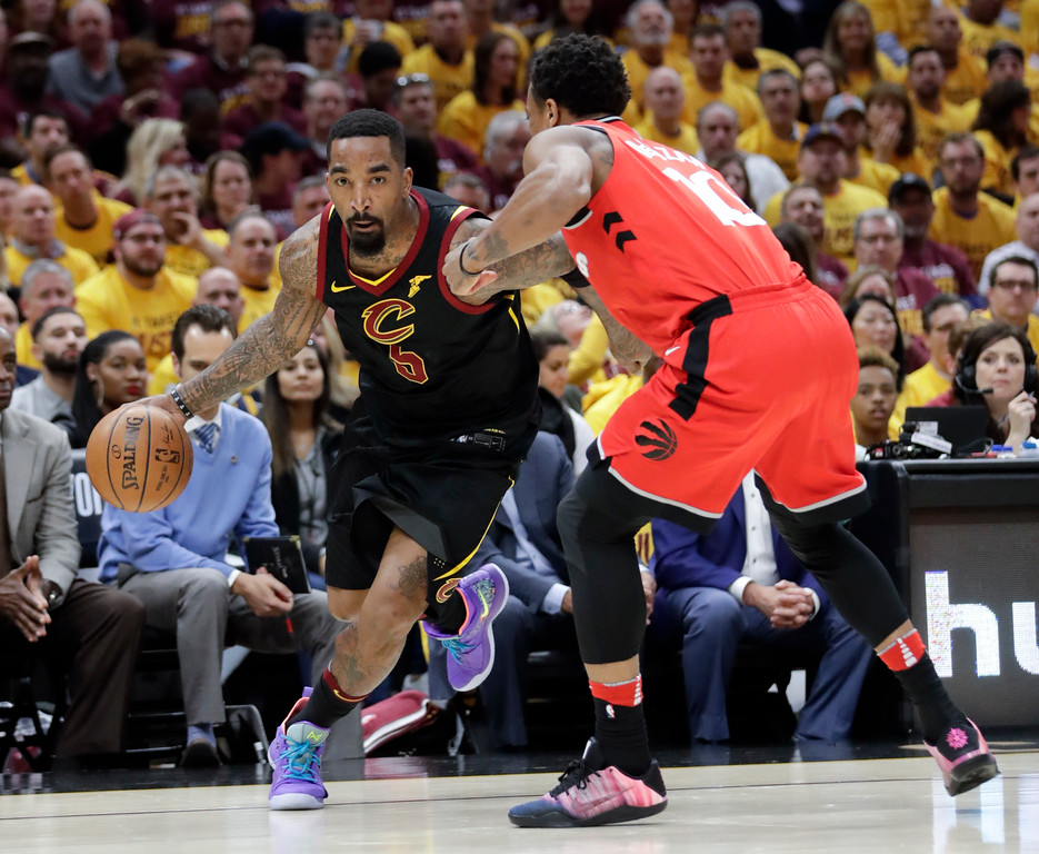. Cleveland Cavaliers\' JR Smith (5) drives on Toronto Raptors\' DeMar DeRozan in the first half of Game 4 of an NBA basketball second-round playoff series, Monday, May 7, 2018, in Cleveland. (AP Photo/Tony Dejak)