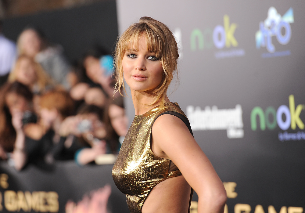 Description of . Actress Jennifer Lawrence arrives at 'The Hunger Games' Los Angeles premiere held at Nokia Theatre L.A. Live on March 12, 2012 in Los Angeles, United States.  (Photo by Jason Merritt/Getty Images)