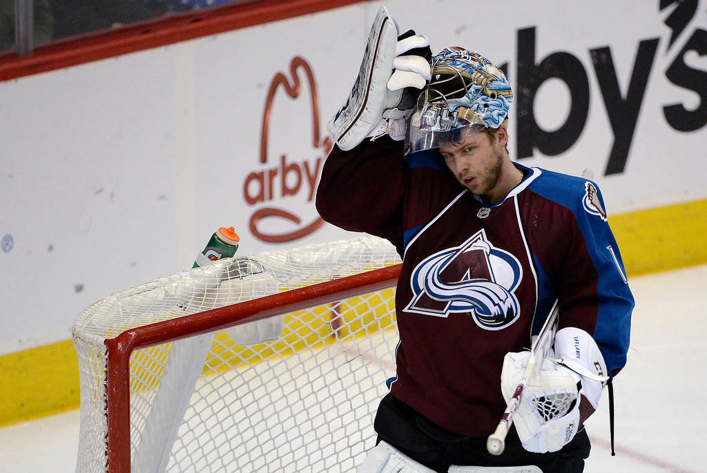 . Colorado Avalanche goalie Semyon Varlamov (1) puts his helmet back on after a timeout in the action against the Philadelphia Flyers January 2, 2014 at Pepsi Center. (Photo by John Leyba/The Denver Post)