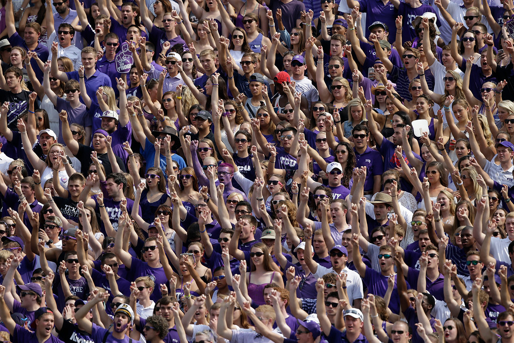 . TCU fans cheer in the stands during the first half of an NCAA college football game against Southeastern Louisiana Saturday, Sept. 7, 2013, in Fort Worth, Texas. (AP Photo/LM Otero)