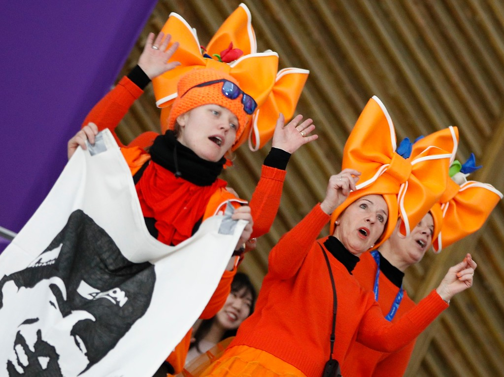 . Fans clad in the colors of the Netherlands team hold a flag with the face of speed skater Sven Kramer of The Netherlands prior to the men\'s 5,000 meters race at the Gangneung Oval at the 2018 Winter Olympics in Gangneung, South Korea, Sunday, Feb. 11, 2018. (AP Photo/Vadim Ghirda)