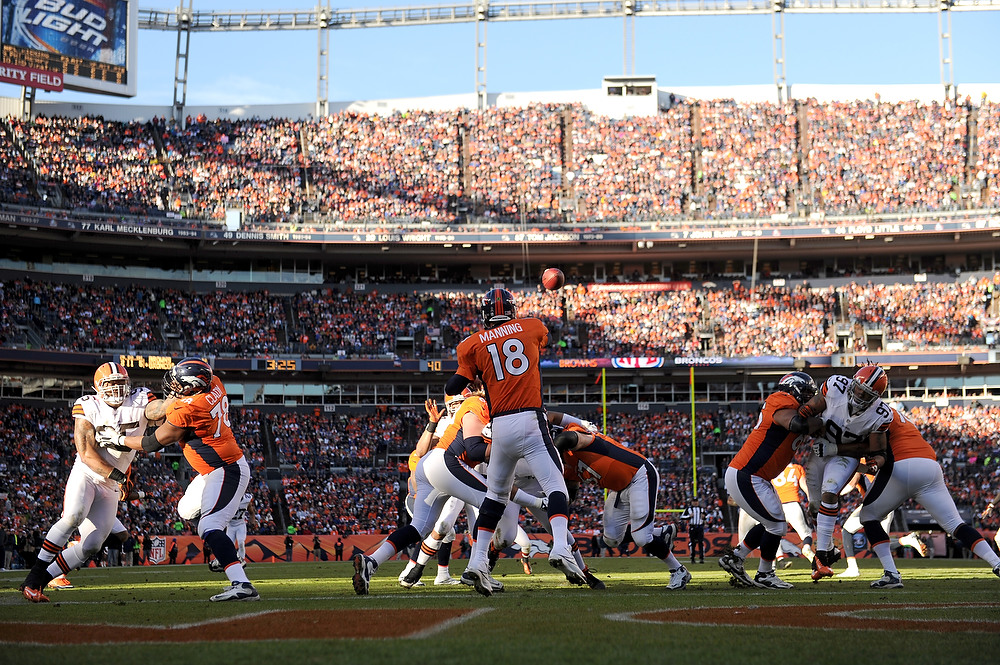 . Denver Broncos quarterback Peyton Manning (18) throws the ball from the end zone during the second quarter. The Denver Broncos vs Cleveland Browns at Sports Authority Field Sunday December 23, 2012. Joe Amon, The Denver Post