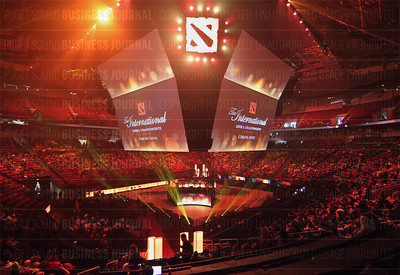 Thousands of fans pack Key Arena at the start of DOTA-2 The International video gaming competition's main event week in Seattle, Washington