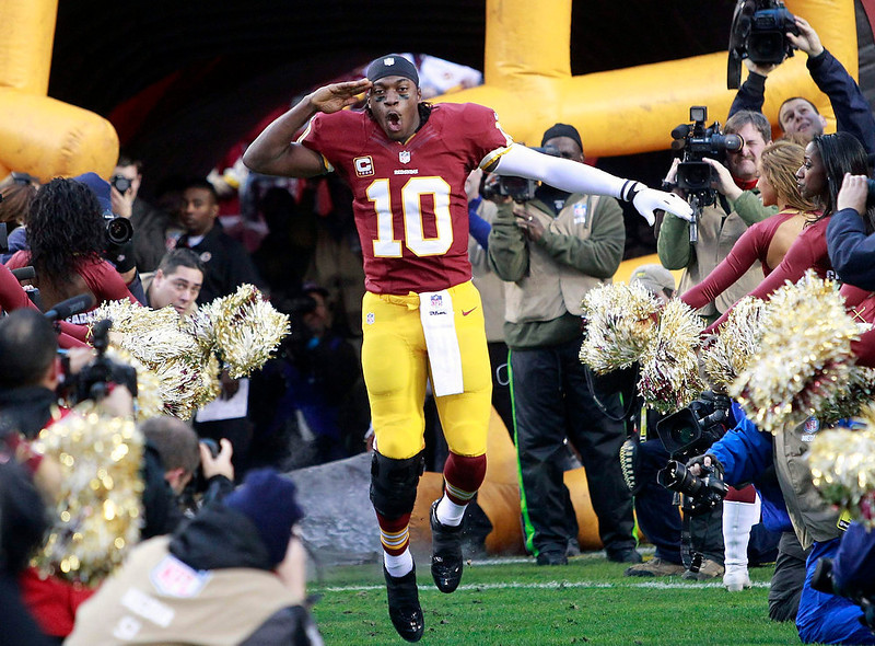 . Washington Redskins quarterback Robert Griffin III (10) is introduced to the home town crowd before playing the Seattle Seahawks in their NFL NFC wildcard playoff football game in Landover, Maryland January 6, 2013. REUTERS/Tim Shaffer