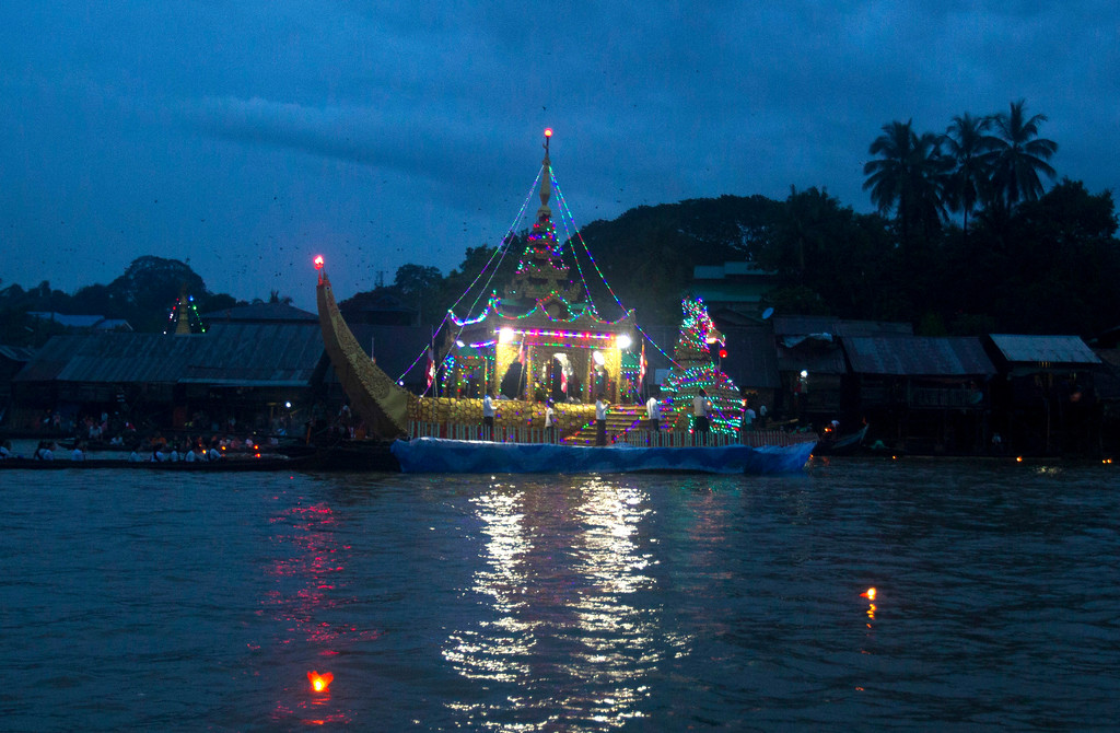 . A huge barge decorated with lights carrying a statue of Shin Upagutta, also known as Upakhut, is seen at Shwe Kyin creek during light festival Friday, Oct. 6, 2017, in Bago, about 183 km from Yangon, Myanmar. Myanmar Buddhists lighted up the sky with fireworks and released paper lanterns down the creek in a ritual believed to bring good fortune during annual light festival celebrating at the end of Buddhist Lent and (AP Photo/Thein Zaw)