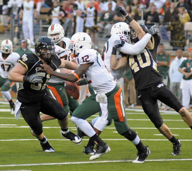 Russell and Ehrmann chase Harris.jpg