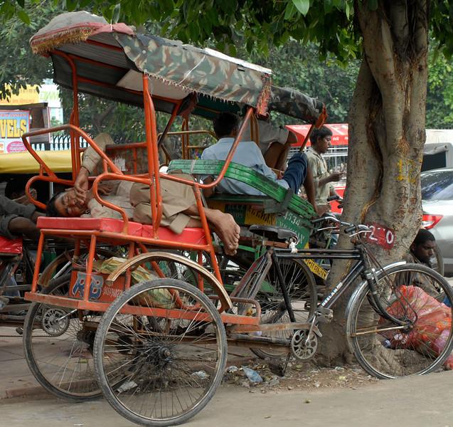A rickshaw driver takes a nap in Old Delhi