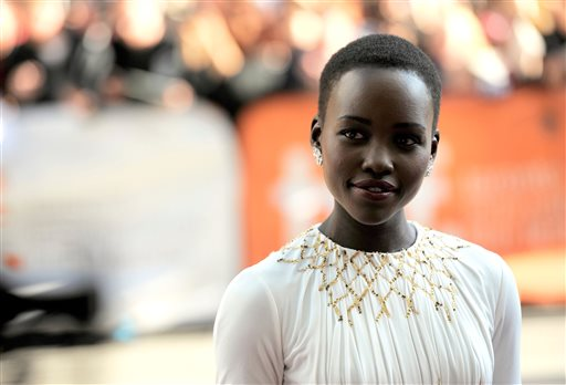 ". Lupita Nyong\'o arrives at the premiere for ""12 Years a Slave\"" on day 2 of the Toronto International Film Festival at The Princess of Wales Theatre on Friday, Sept. 6, 2013, in Toronto. (Photo by Chris Pizzelloi/Invision/AP)"