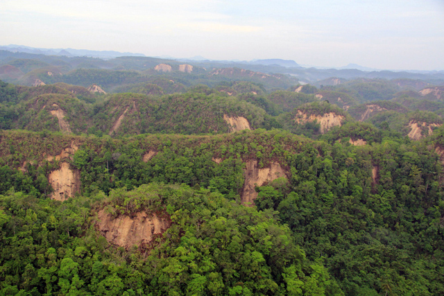 . This handout photo taken on October 16, 2013 and released on October 17 by Philipine air force (PAF) shows an aerial shot of the famous tourist spot of the Chocolate Hills with its side eroded, in Tagbilaran City, Bohol province, central Philippines, after a 7.1 earthquake hit the tourist island destination october 15.  AFP PHOTO/PAF                                    AFP PHOTO /PAF/AFP/Getty Images